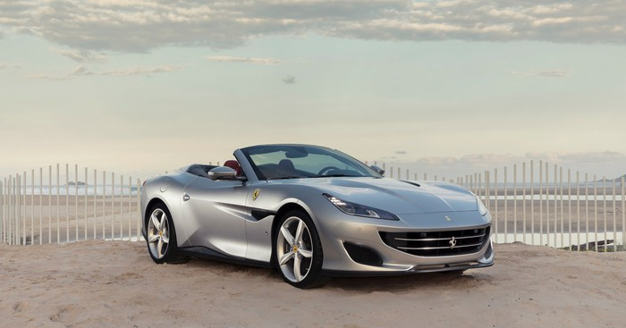 A silver Ferrari Portofino, a front-engined, four-seat convertible grand touring car.