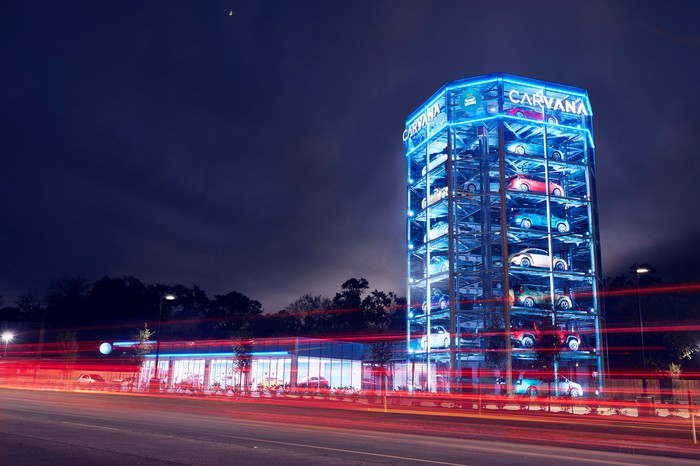 Carvana's vending machine at night, lit up and filled with cars.