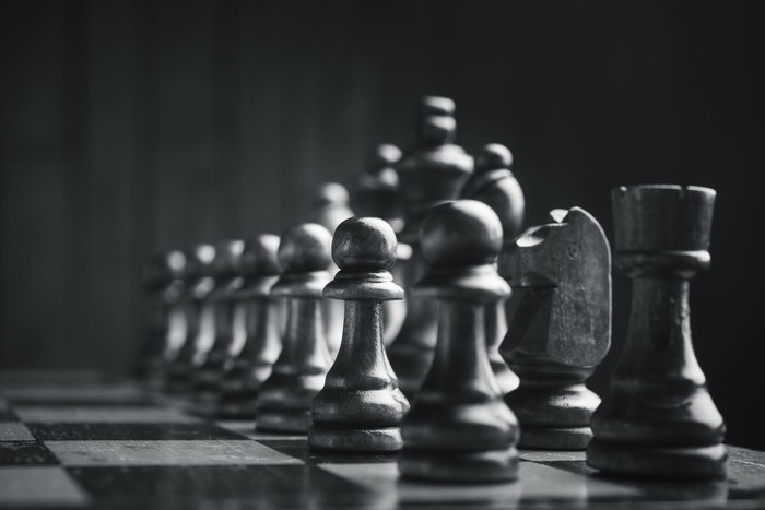 A chessboard at initial set-up. The black chess pieces are pictured.