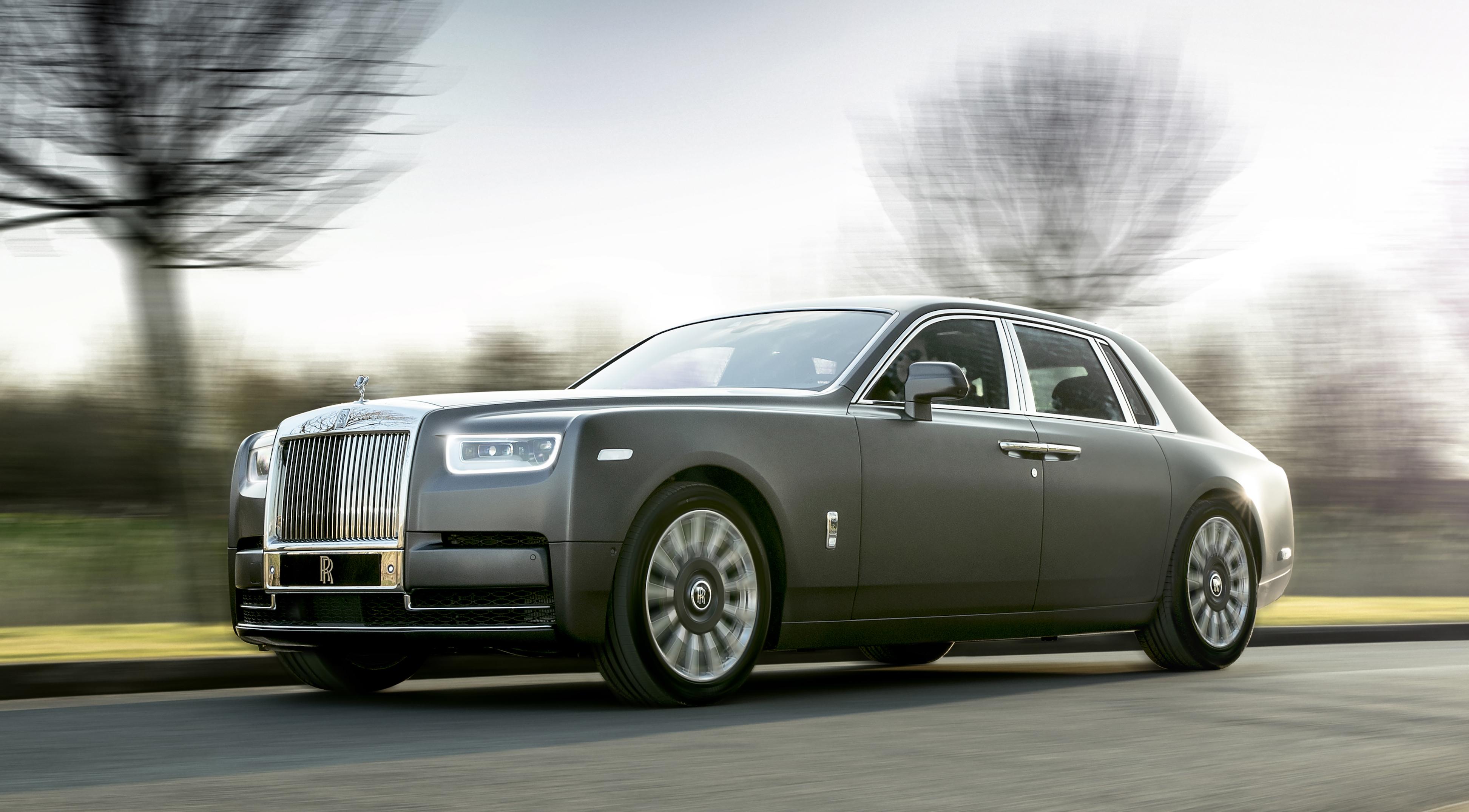 A dark gray 2018 Rolls-Royce Phantom, a large and opulent super-luxury sedan