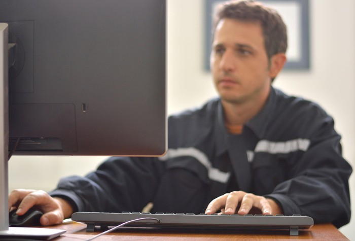 Man sitting at a computer