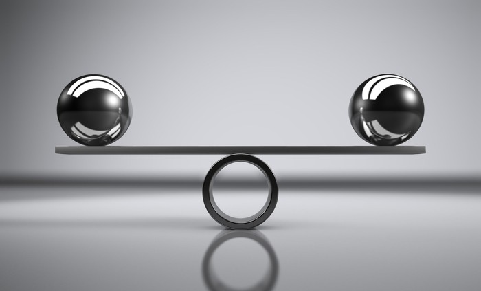 Two balls balancing each other
