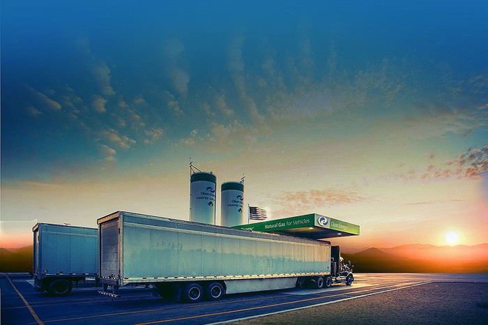 Sunrise as two trucks refuel at Clean Energy Fuels station.