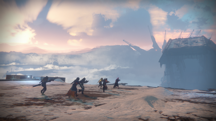 Six characters navigating a desert environment in Destiny 2.