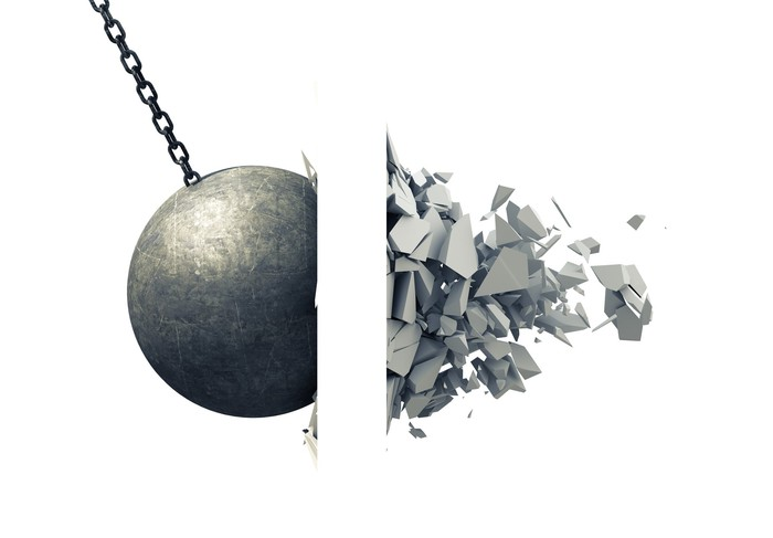 A wrecking ball hits a wall