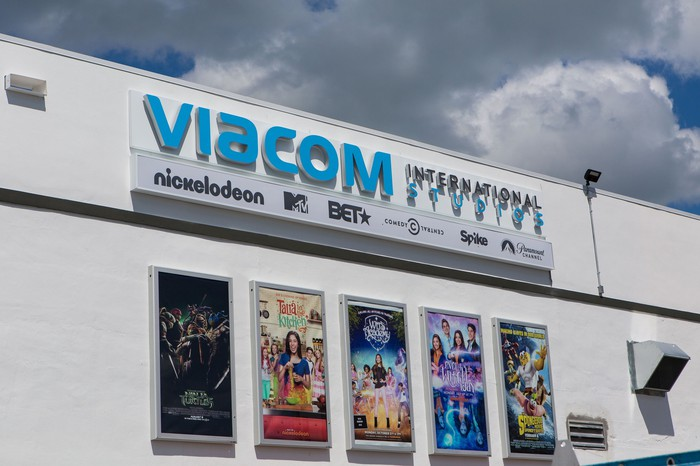Viacom international studio storefront, with posters from various movies on a white building.