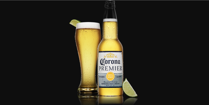Corona beer in a bottle and a glass with lime