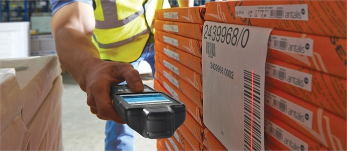 A worker uses a Zebra-branded barcode reader to read a barcode.