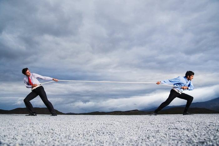 Two men playing tug of war.