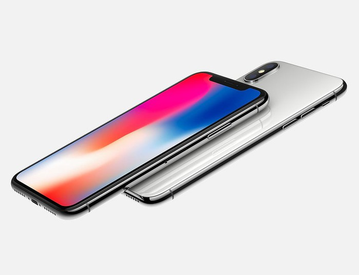 The Apple iPhone X featuring an OLED display. The screen has a rainbow of bright colors displayed.