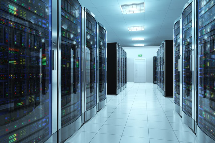 Interior of a data center with rows of servers.