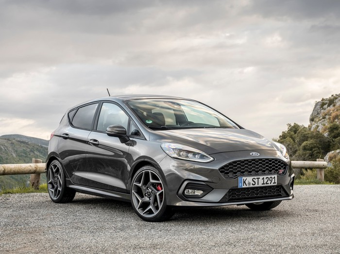 A European-spec 2018 Ford Fiesta ST hatchback in dark gray, parked on a mountain road
