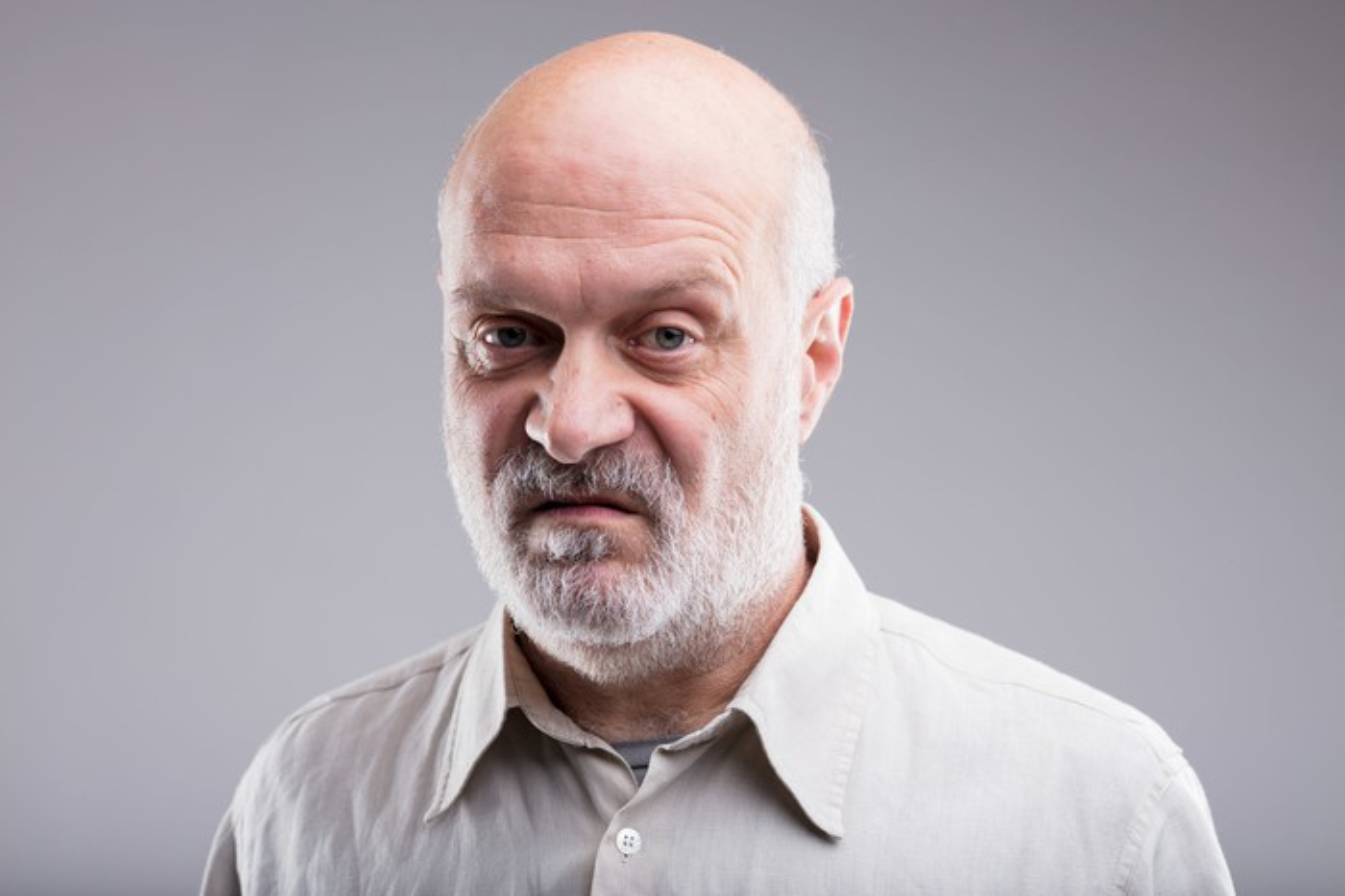 Older man scowling