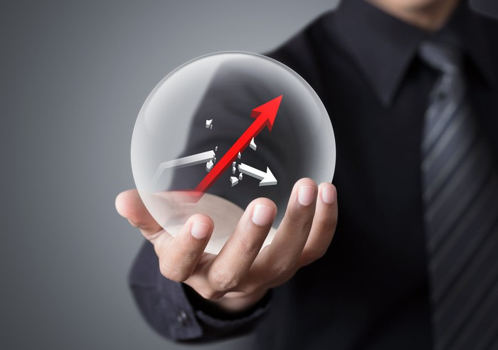 A man holding a bubble that encapsulates two arrows, with one of the arrows breaking through and rising above the other.