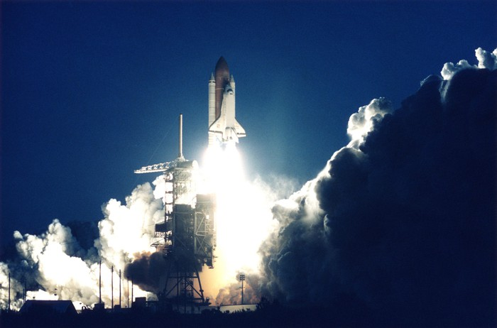 A space shuttle taking off.