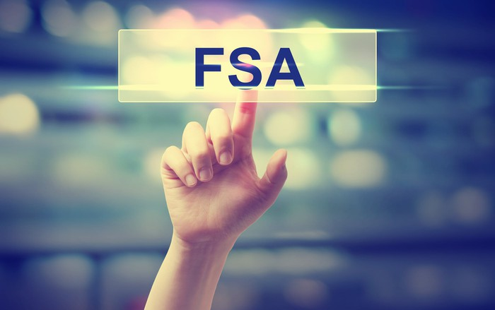 Finger pointing to hanging image of sign saying FSA.
