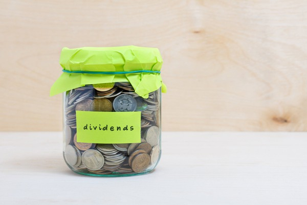 Dividends label on a jar full of coins