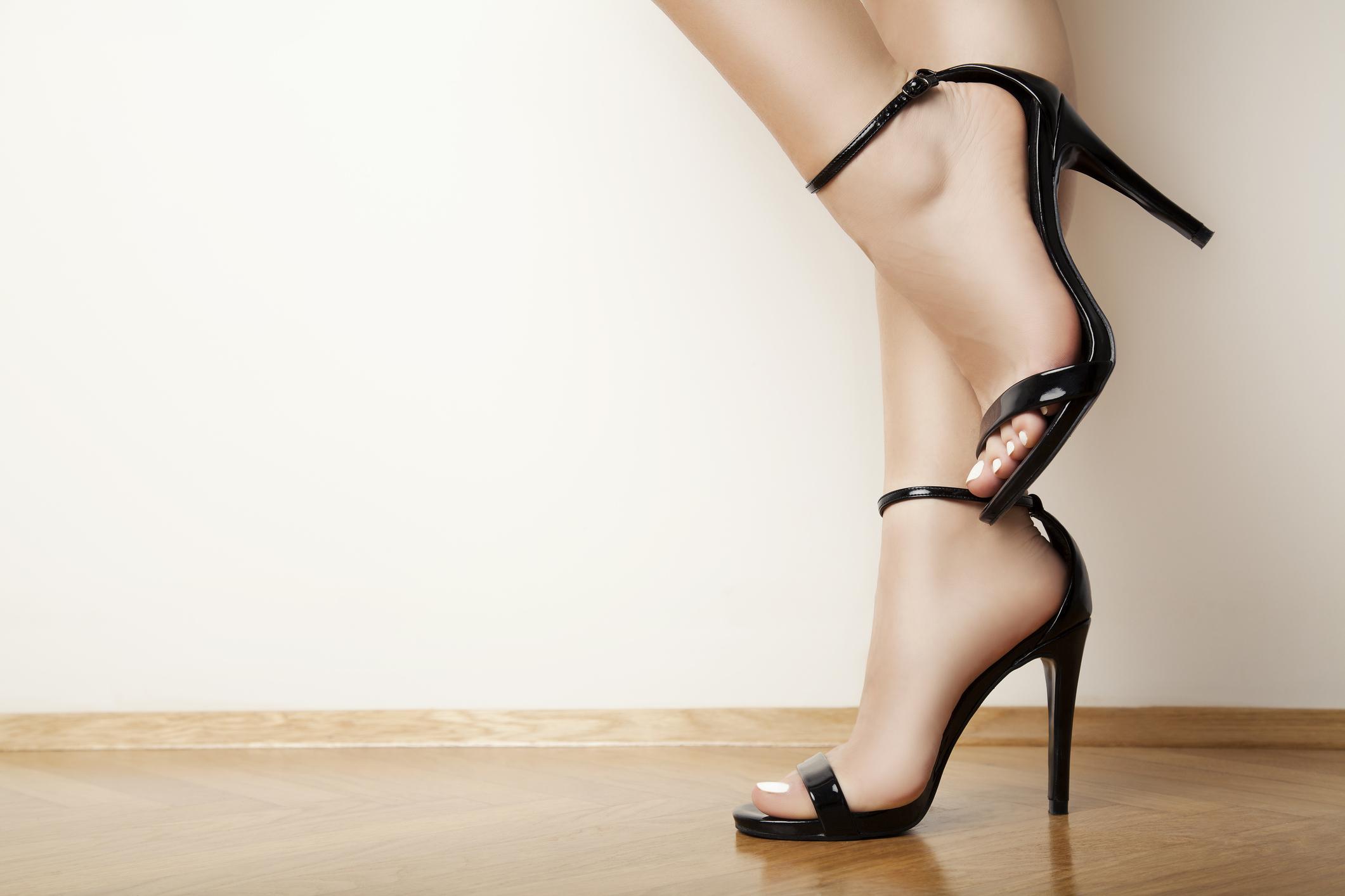 Woman modeling black high heels.