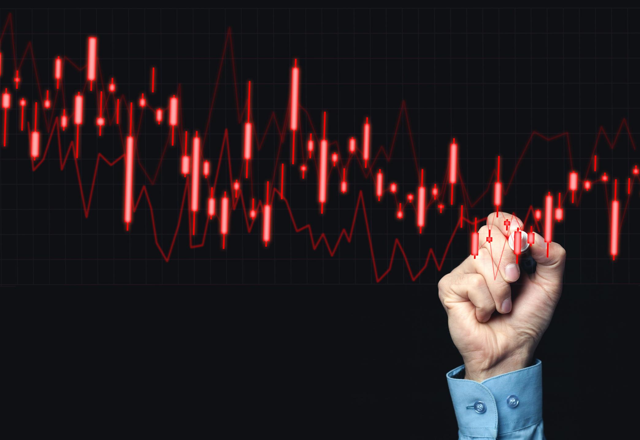 Hand drawing falling stock graph.