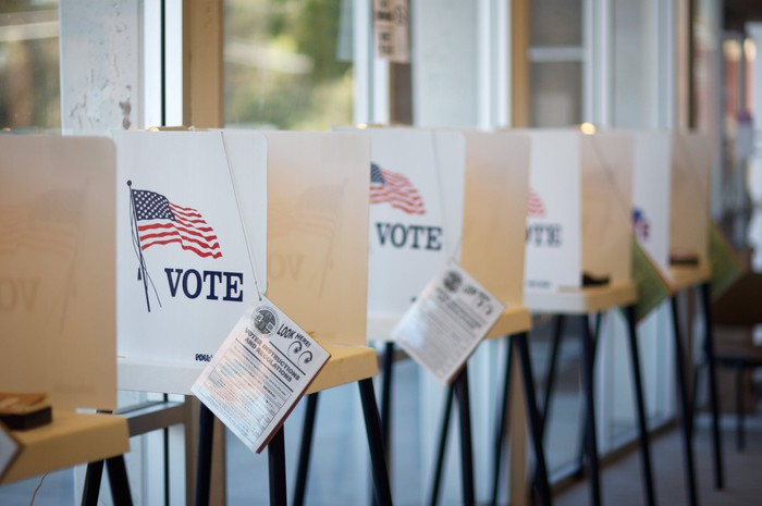 Line of voting booths with American flags on them