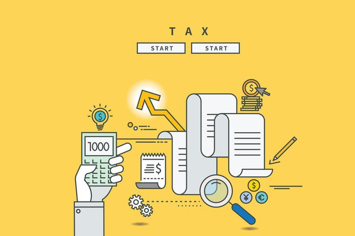 Colorful illustrated concept of tax forms, calculator, dollar signs, pencils, etc.