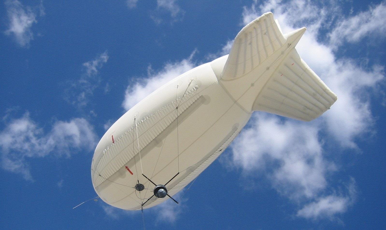Raven Industries Aerostat blimp in the sky as seen from below.