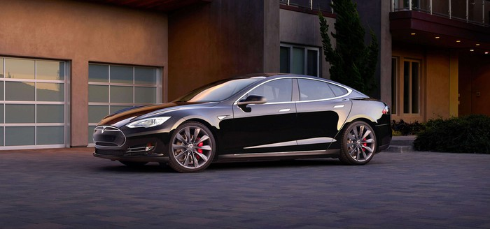 Tesla Model S in front of a house.