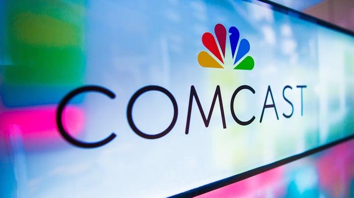 Comcast logo featuring the NBC peacock logo.