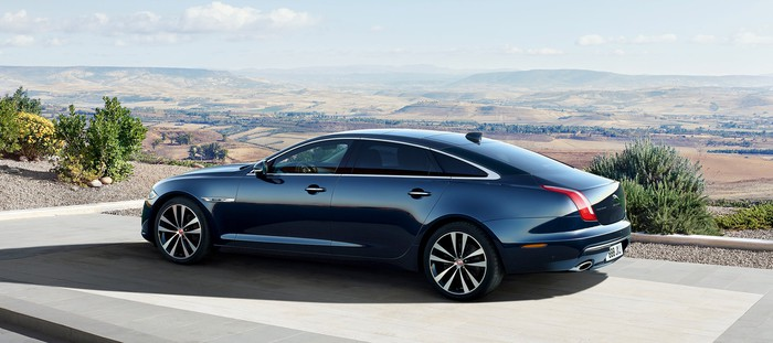 A black 2018 Jaguar XJ, a long, sleek luxury sedan.