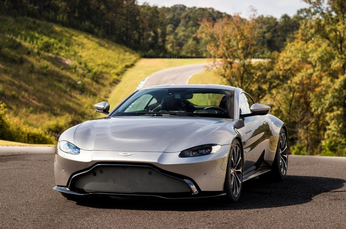 A silver Aston Martin V8 Vantage, a two-seat sports car with sleek, aggressive styling.