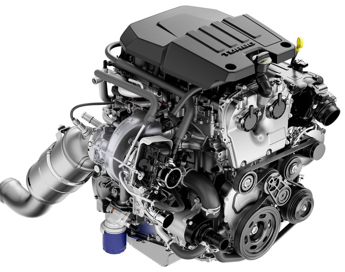 A tightly-packaged four-cylinder engine, with all accessories mounted.