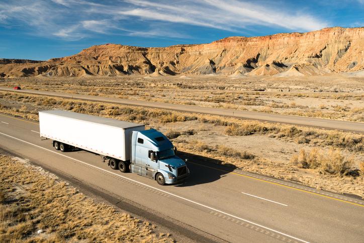 A semi truck in the desert.