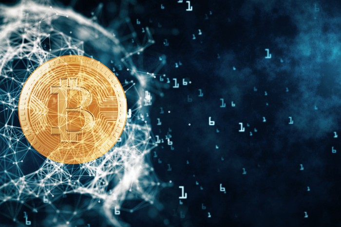 A Bitcoin floating in what appears to be outer space.