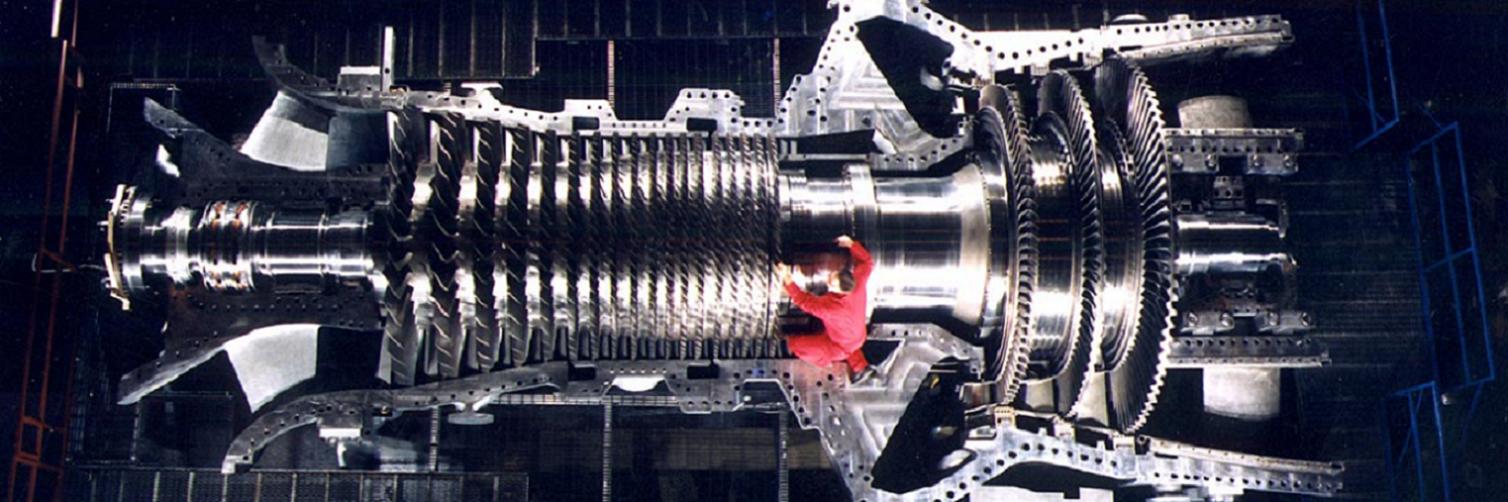 a man working o a GE gas turbine