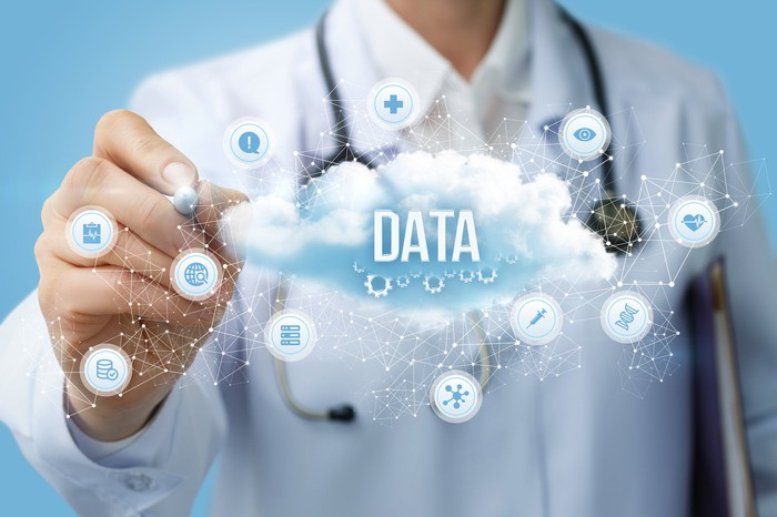 Doctor drawing the structure of a data cloud