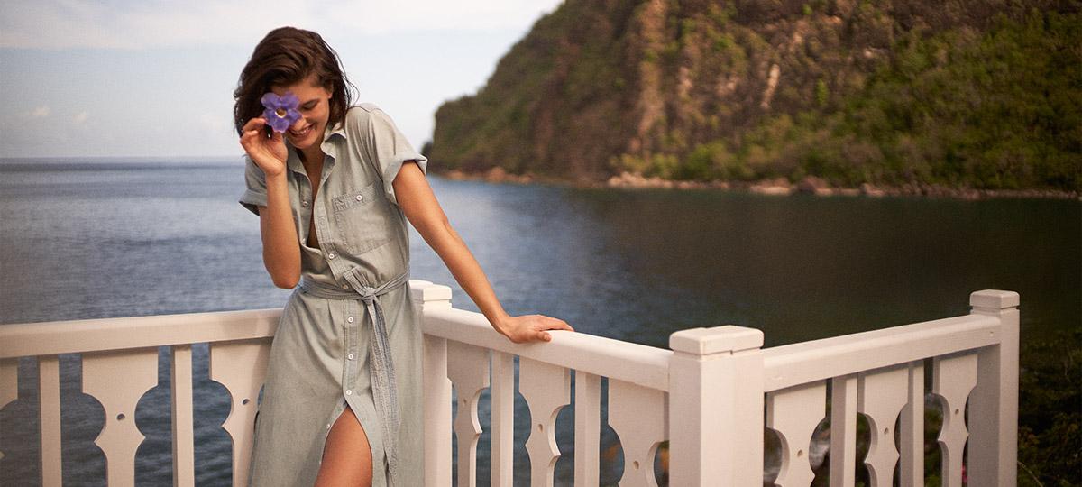 A model wearing a Ralph Lauren dress.