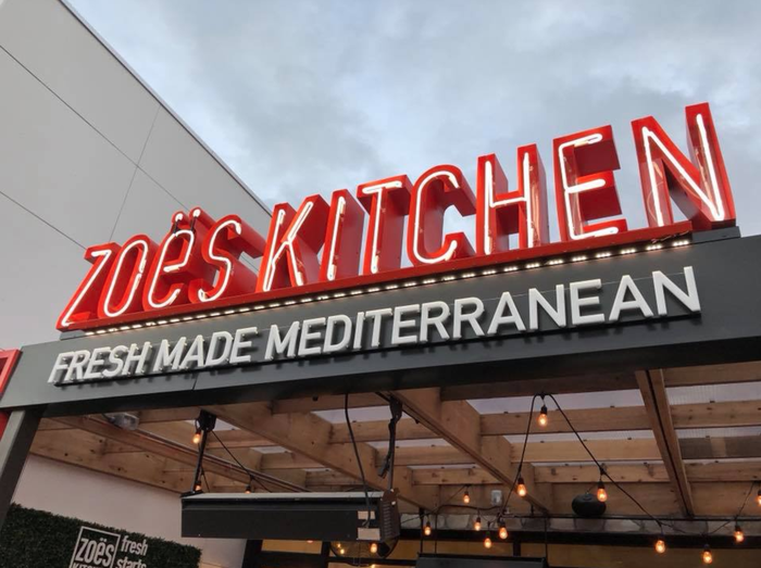 A Zoe's Kitchen restaurant sign