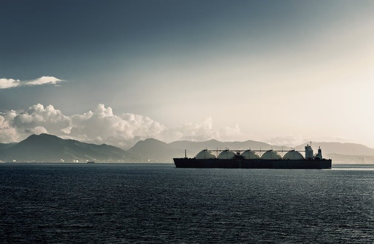 An LNG carrier arriving at a port.