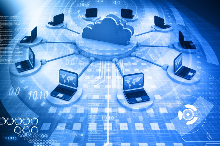 An artist's rendering of computers getting hooked up to a cloud, on top of a blue background with numbers and squares.