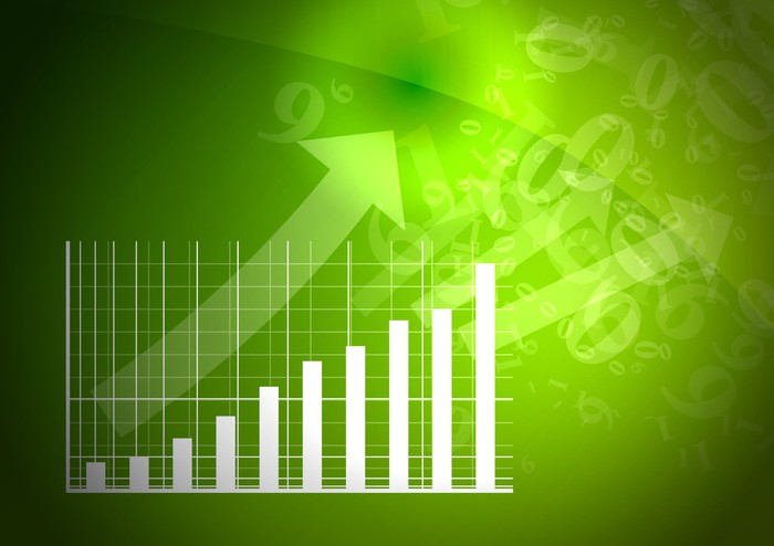 An arrow pointing up and to the right as it tracks growth on a bar chart.