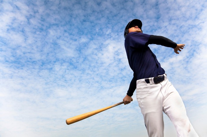 Baseball player completing swing
