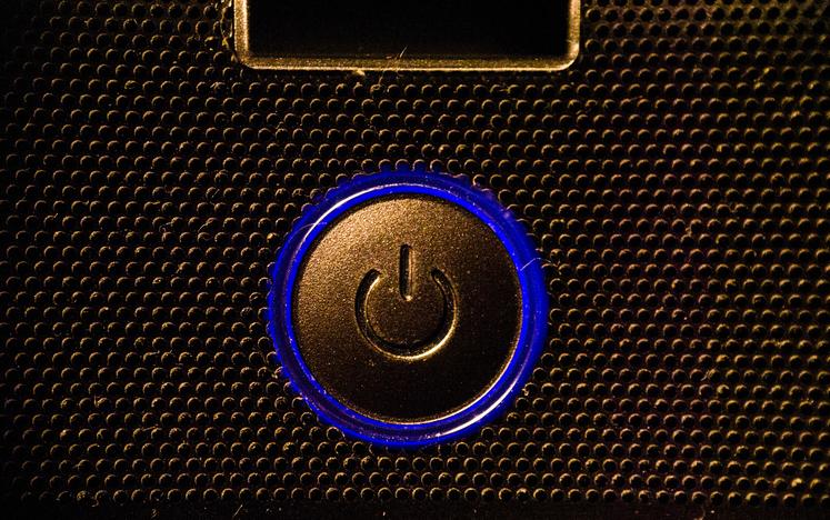 A blue power button.