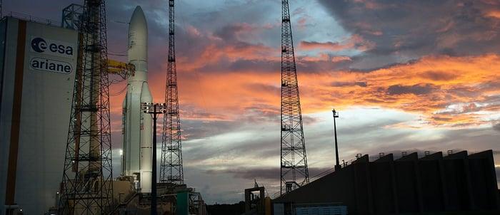 Ariane rocket on pad at sunset