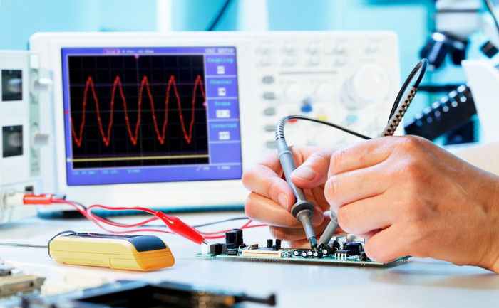 Person using an oscilloscope