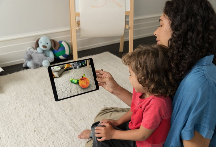 A mom using augmented reality apps with her child