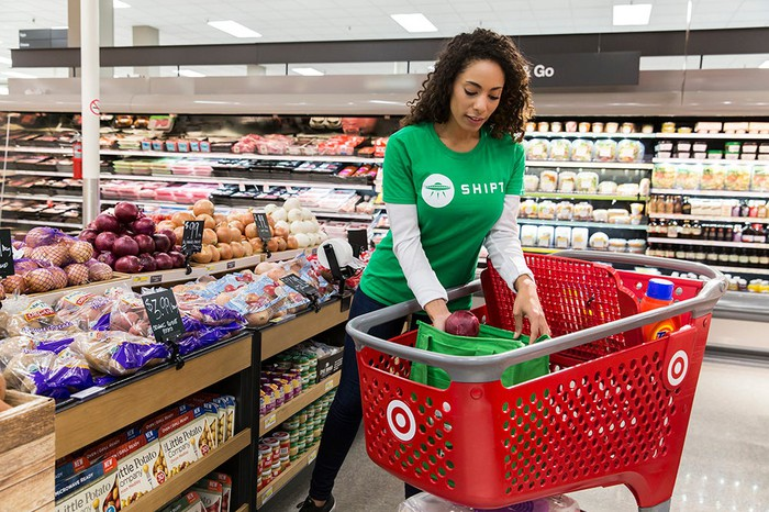 Shipt worker fills Target cart with groceries.