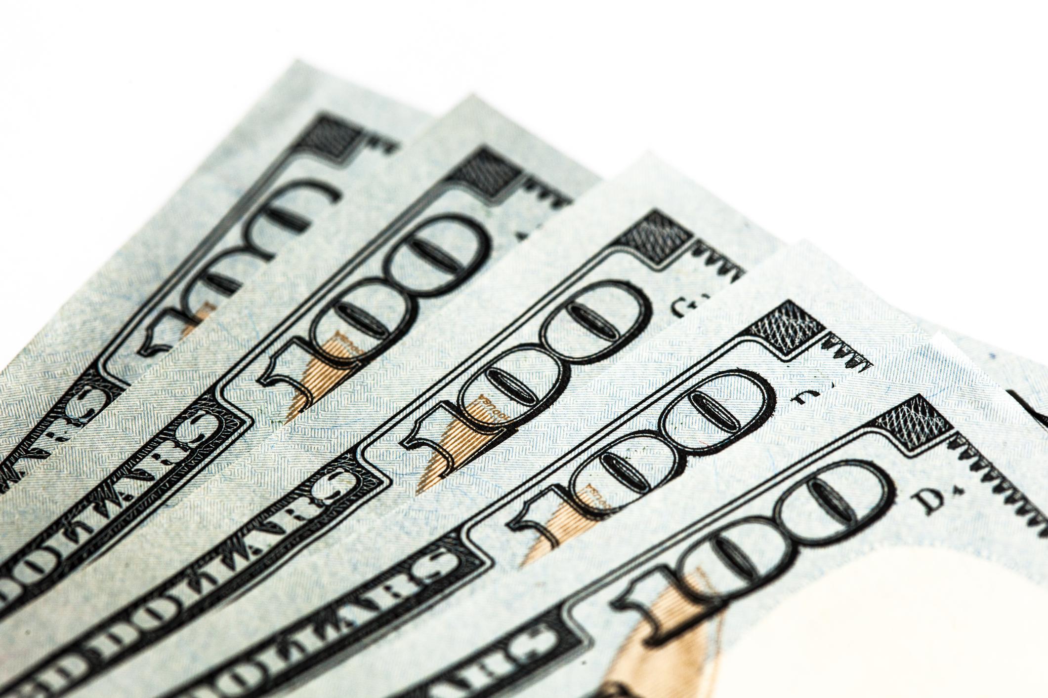 Five $100 bills
