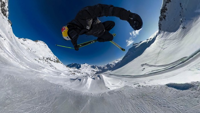 Spherical image of snowboarder on a mountain.
