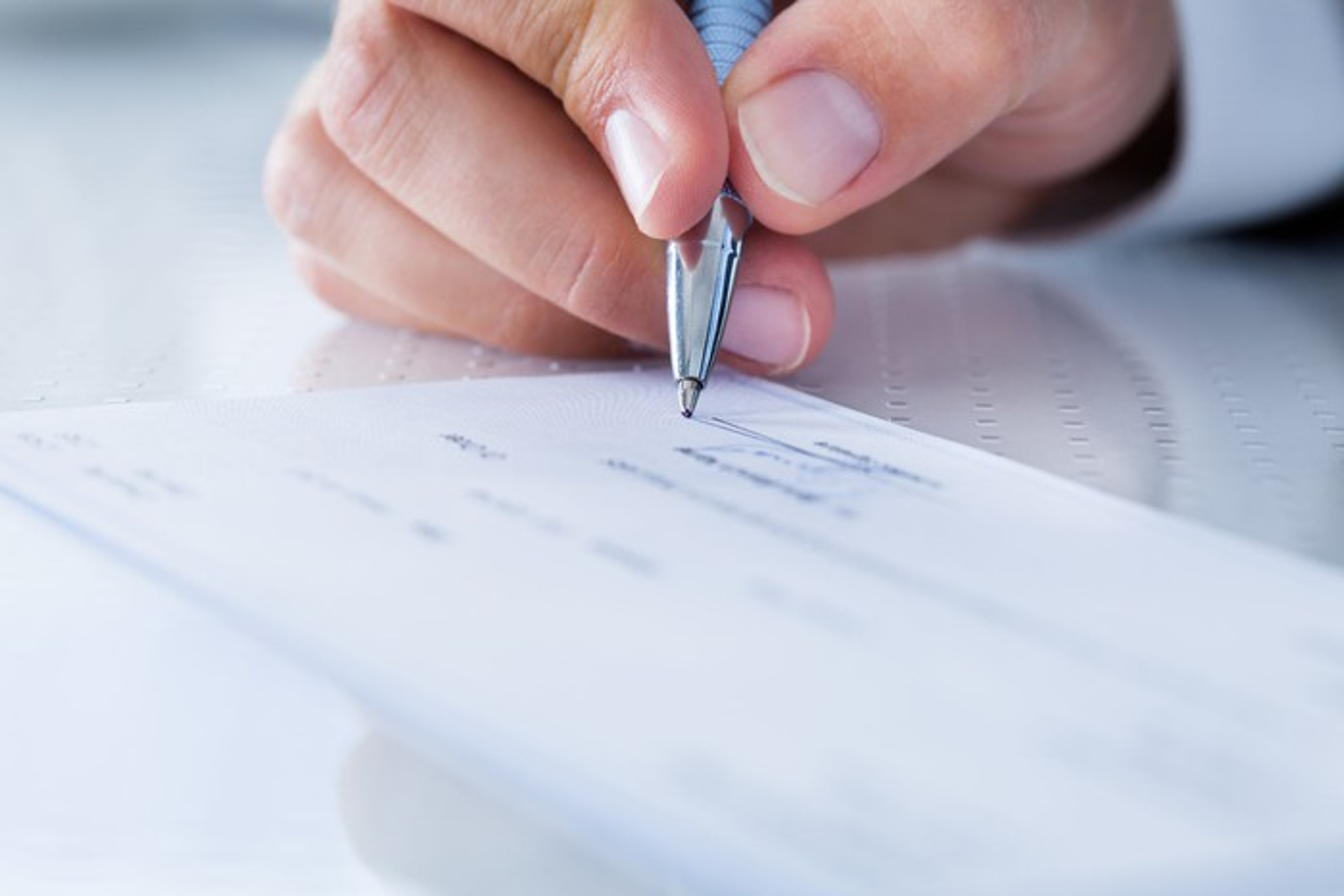A man signs a check.