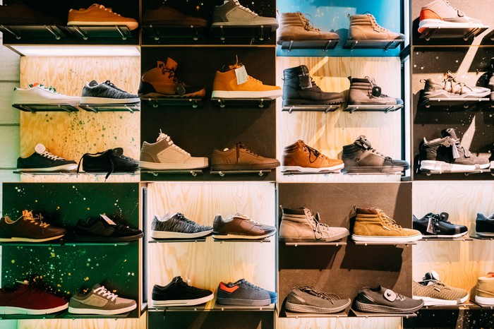 A wall of shoes in a shoe store.
